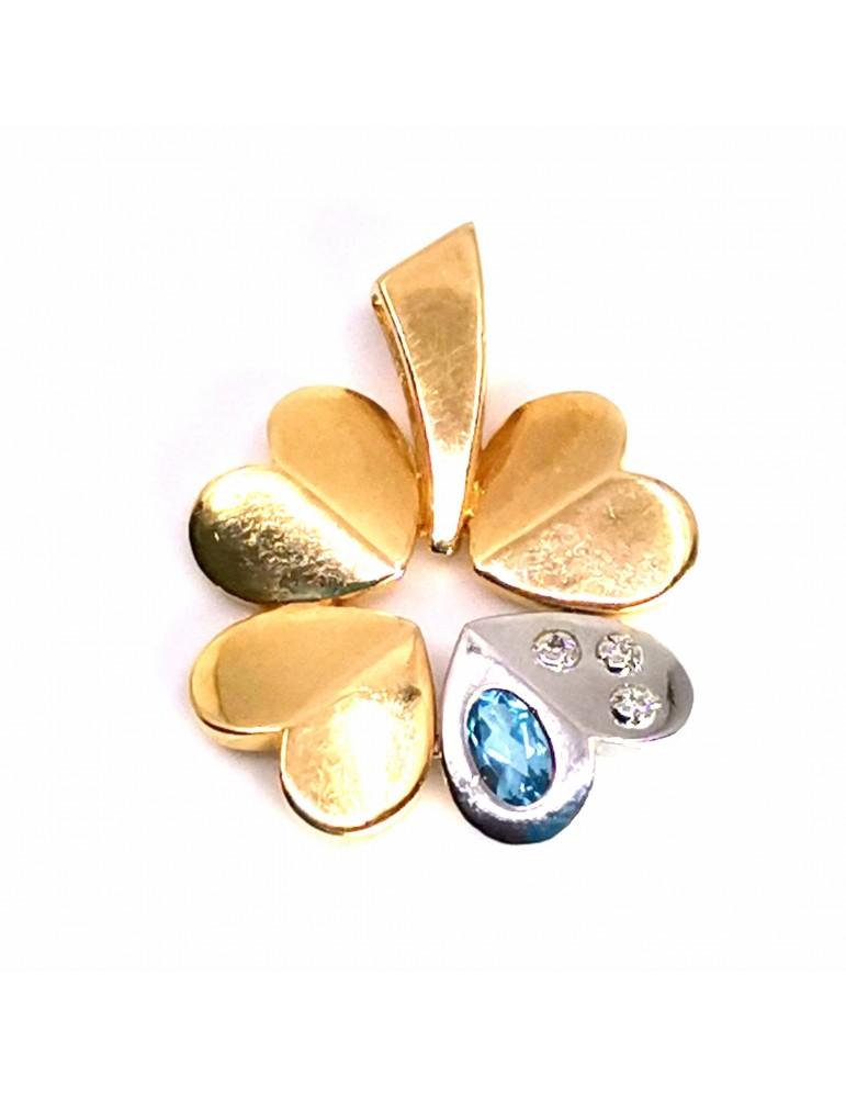 Colgante en bicolor con oro amarillo y oro blanco de 18k y 4 corazones, piedra topacio azul y 3 circonitas